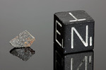 INDARCH - Caduta il 7 Aprile 1891, Shusha Elisavetpol, Russia. Enstatite Chondrite EH4. Massa totale recuperata 27 kg. Pezzo in collezione: fetta gr.0.098 (McM393)